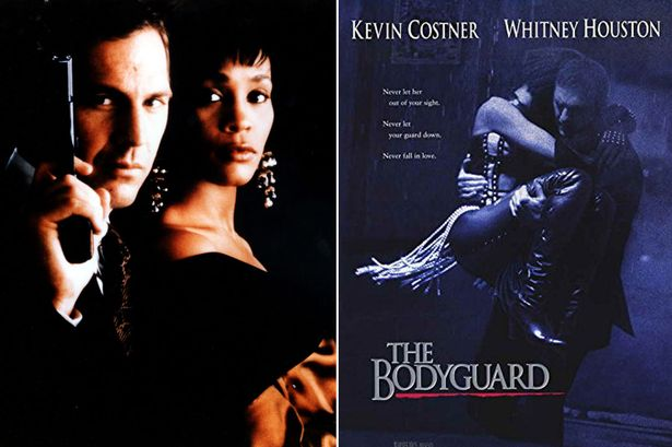 Kevin Costner carrying Whitney Houston in The Bodyguard
