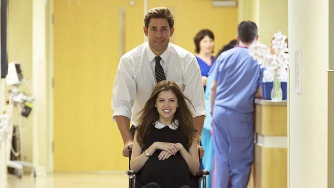 John Krasinski pushing Anna Kendrick in a wheelchair in The Hollars
