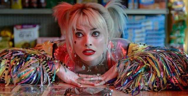 Margot Robbie in colorful vest as Harley Quinn in Birds of Prey