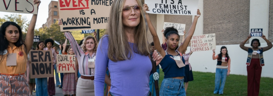 Julianne Moore as Gloria Steinem standing in front of protestors