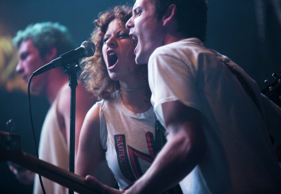 Anton Yelchin and Alia Shawkat singing into microphone in Green Room movie
