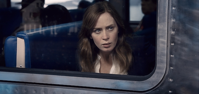 emily blunt sitting on the train in the girl on the train