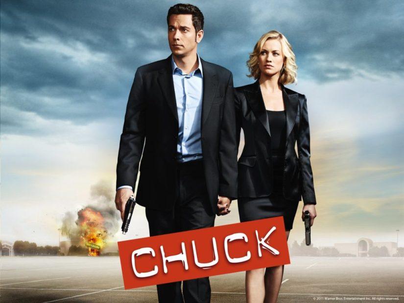 Yvonne Strahovski and Zachary Levi holding hands on Chuck poster