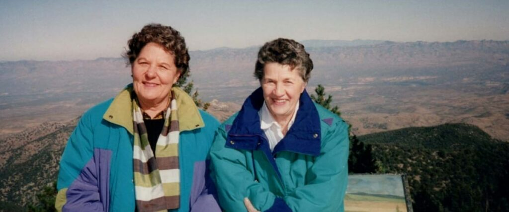 Terry Donahue and Pat Henschel posing at the Grand Canyon