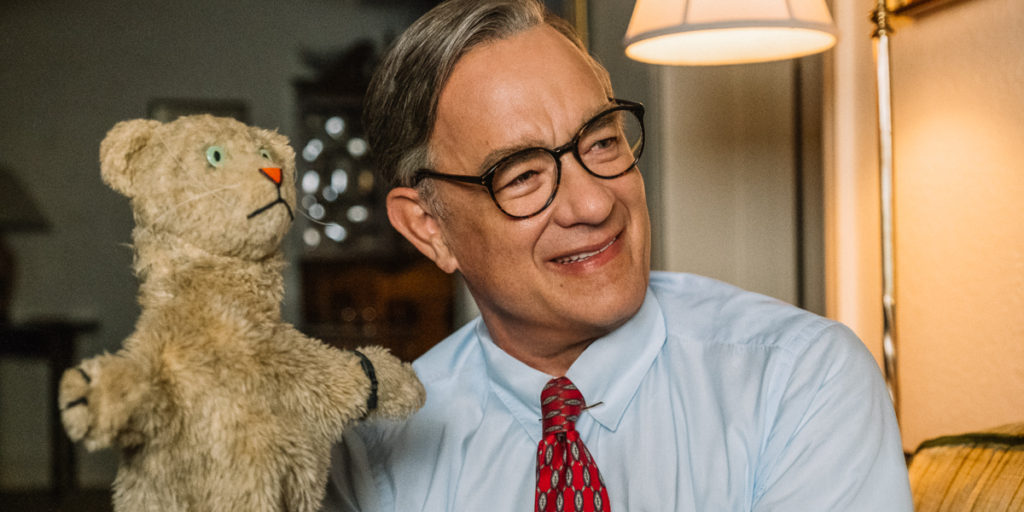 Tom Hanks as Fred Rogers with puppet Daniel the Lion in A Beautiful Day in the Neighborhood