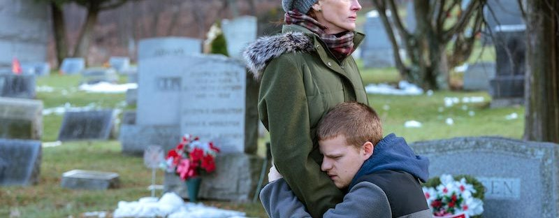 Lucas Hedges hugging Julia Roberts in cemetery in Ben is Back