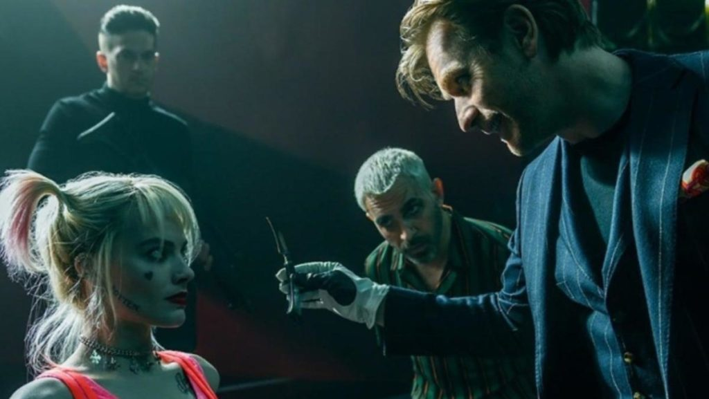 Ewan McGregor holding knife to Margot Robbie/Harley Quinn in Birds of Prey.