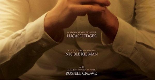 lucas hedges kneeling in prayer in boy erased movie poster