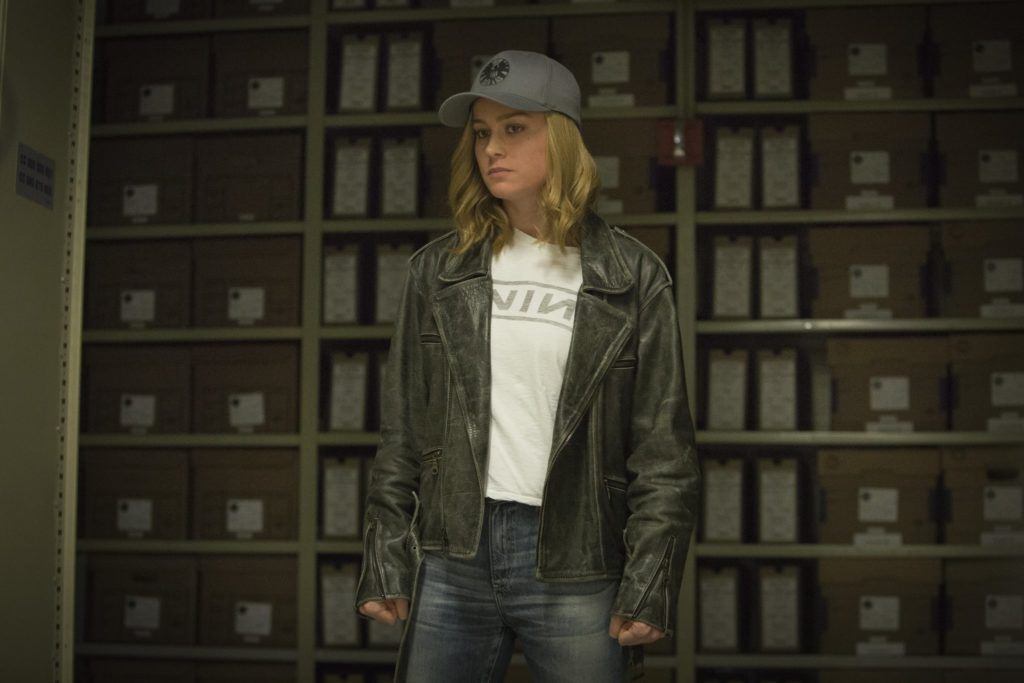 Brie Larson in Nine Inch Nails shirt and leather jacket as Carol Danvers in Captain Marvel
