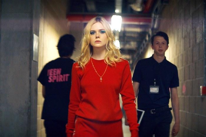 Elle Fanning in red sweatsuit for Teen Spirit