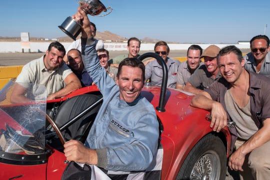 Christian Bale winning cup in Ford v Ferrari