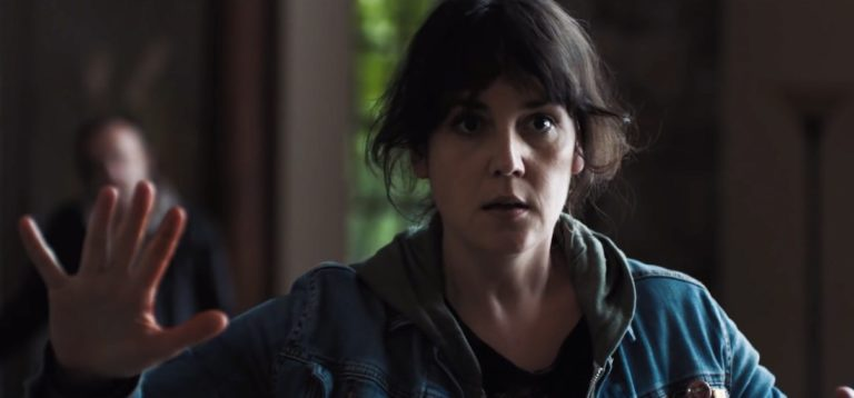 Melanie Lynskey holding out her hand in i don't feel at home in this world anymore movie