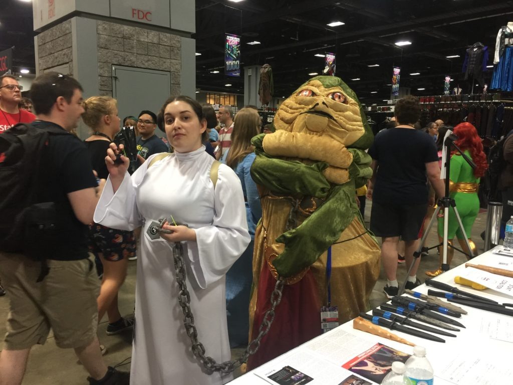 star wars cosplay with princess leia and jabba the hut in a bikini and chains at awesome con in washington, dc