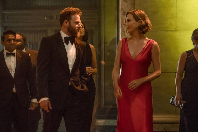 Seth Rogen and Charlize dressed up in The Long Shot