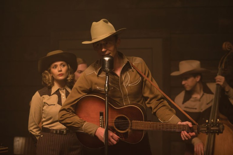 Tom Hiddleston playing the guitar as Hank Williams and singing with Elizabeth Olsen in I Saw The Light