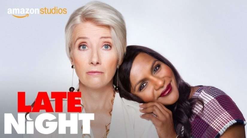 Mindy Kaling leaning on Emma Thompson in Late Night