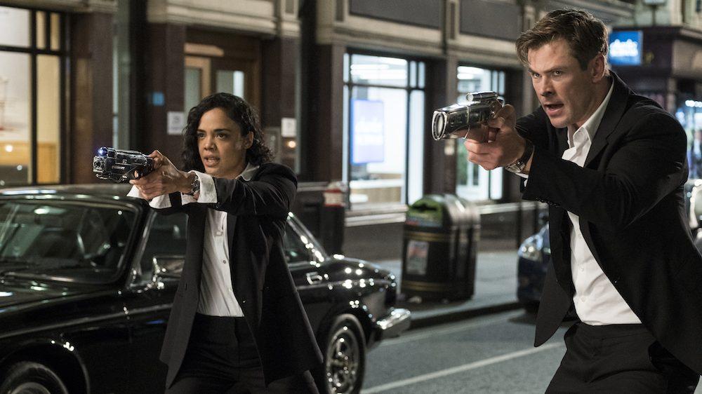 Chris Hemsworth and Tessa Thompson shooting guns in Men In Black: International