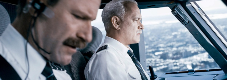 aaron eckhart tom hanks sitting in a cockpit in sully movie