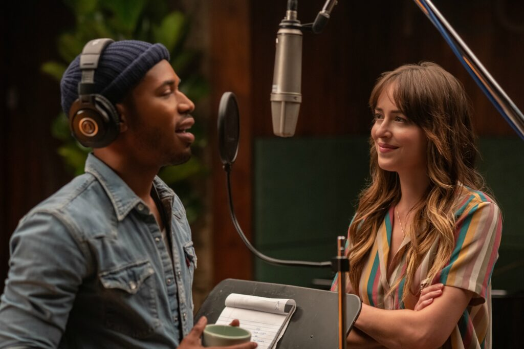 Dakota Johnson and Kelvin Harrison Jr. singing in a sound booth in The High Note