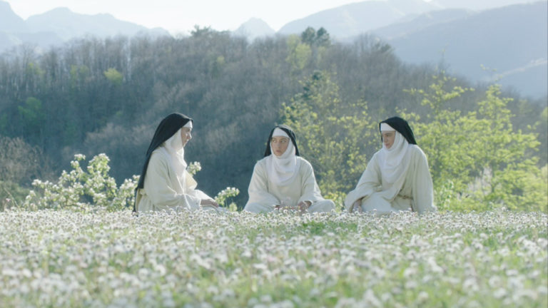 Aubrey Plaza and Alison Brie as nuns sitting in meadow The Little Hours