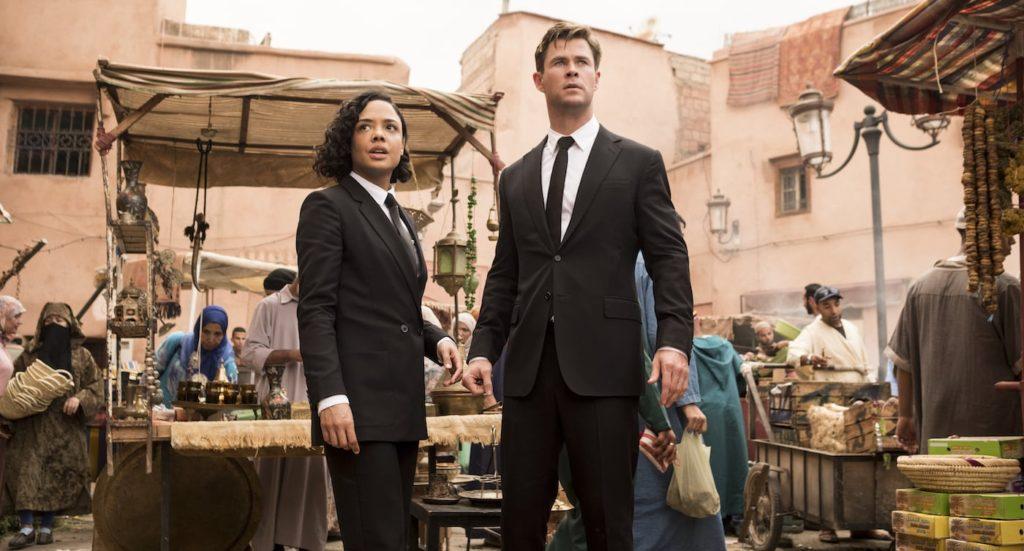 Chris Hemsworth and Tessa Thompson in market in Men In Black: International
