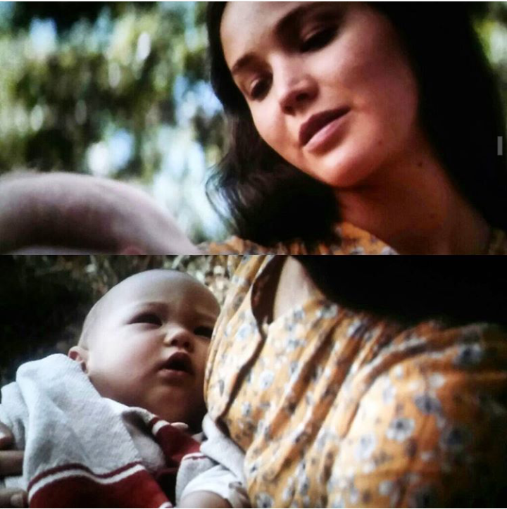 Katniss with baby in The Hunger Games Mockingjay