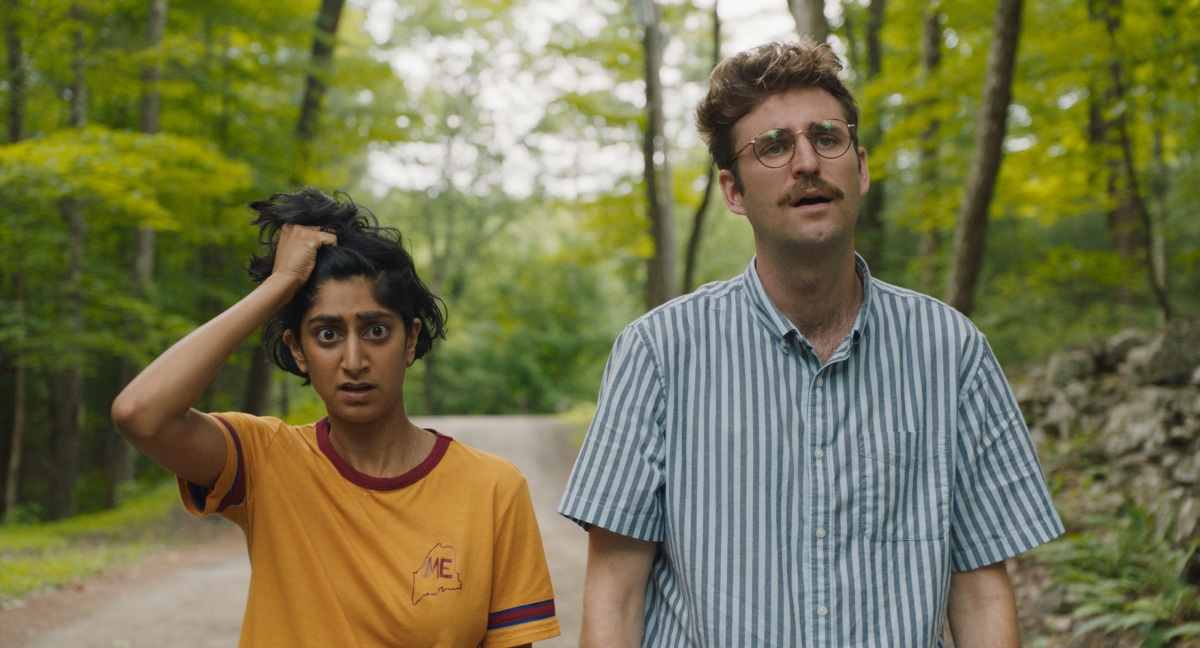 John Paul Reynolds and Sunita Mani walking on a road in Save Yourselves