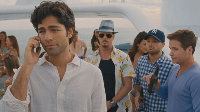 Vince (Adrian Grenier) on the phone with the case of Entourage