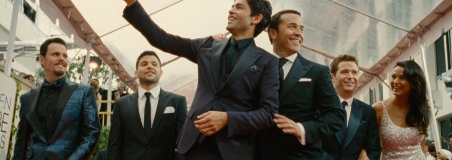 Vince (Adrian Grenier) waving on the red carpet with the cast of Entourage
