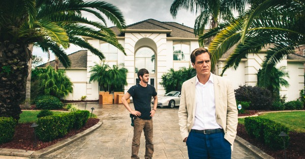Michael Shannon and Andrew Garfield standing in front of a house in 99 Homes