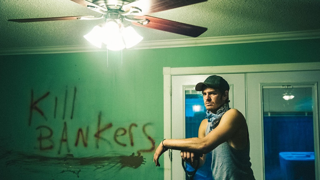 Andrew Garfield in bedroom with kill bankers graffiti in 99 Homes