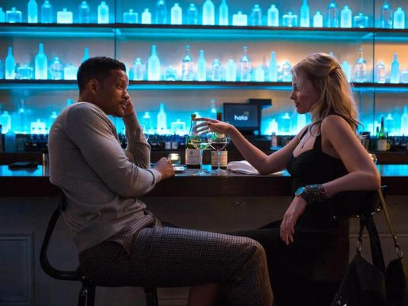 Will Smith and Margot Robbie at a bar in Focus