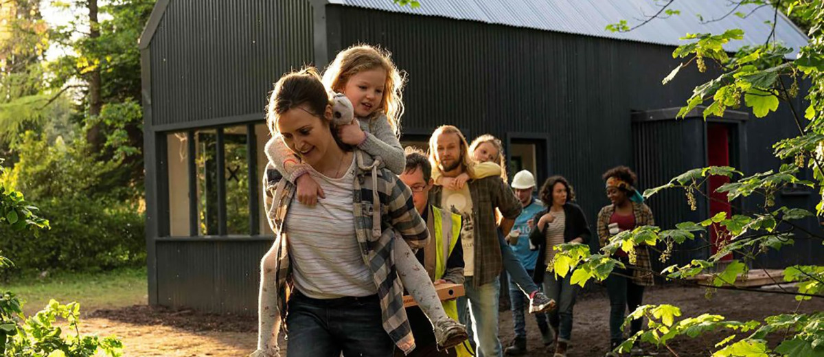 Clare Dunne with kid piggyback in Herself movie