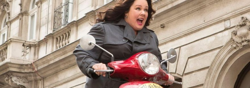 Melissa McCarthy on a vespa scooter in Spy