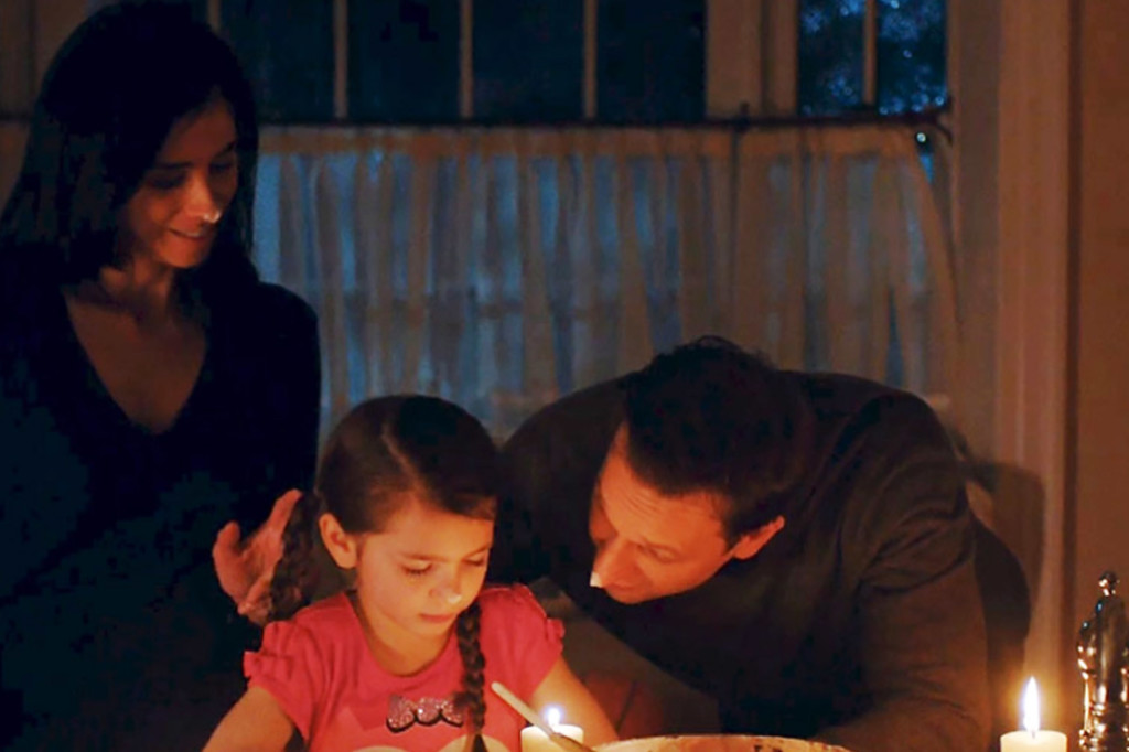 Sarah Silverman and Josh Charles blowing out birthday cake candles