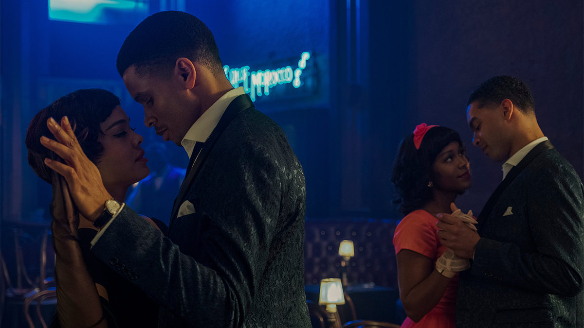 Tessa Thompson and Nnamdi Asomugha dancing in a club