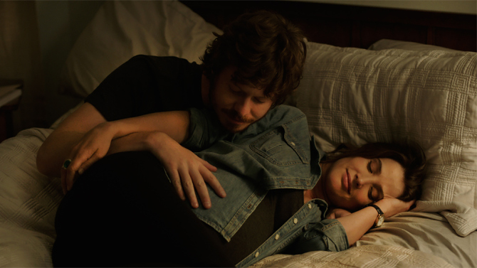 Anders Holm and Cobie Smulders in bed in Unexpected