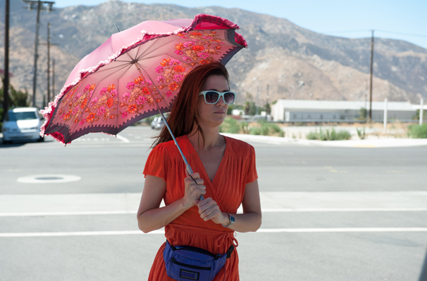 Kristen Wiig with an umbrella in Welcome to Me