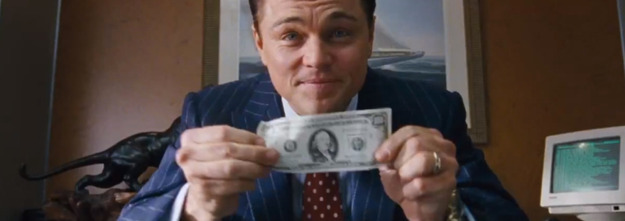 Leonardo DiCaprio holding up money in Wolf of Wall Street
