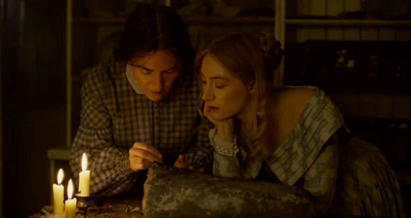 Ammonite movie Saoirse Ronan and Kate Winslet looking at a fossil