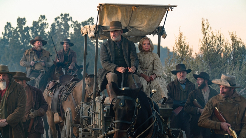 News of the World Tom Hanks steering a wagon